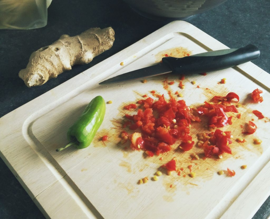Finely chop one chilli and loosely chop the other.